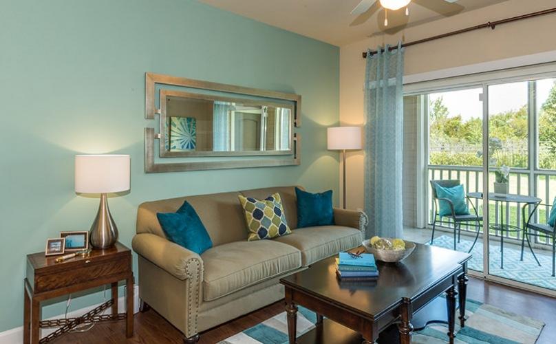 open living room with sliding glass door to balcony