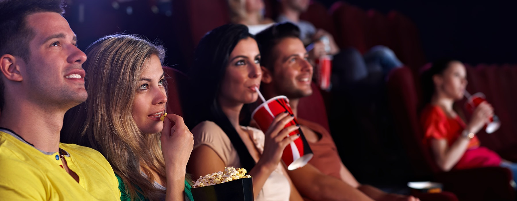 stock image of couple at movie theater